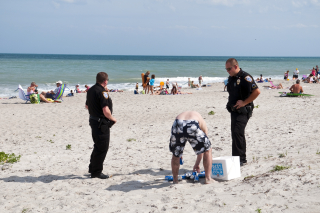 Police Beach Beer Image istock